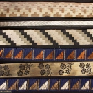 NINE WOVEN SILK DECO RIBBONS, 1920-1930s