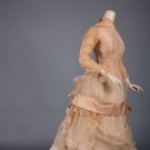 TAN SILK & ORGANDY BUSTLE GOWN, 1870s