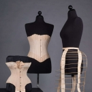 TWO CORSETS & ONE BUSTLE CAGE, 1870-1890s