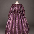 GIRL'S DAY DRESS OF PLAID PURPLE SATIN, c. 1850